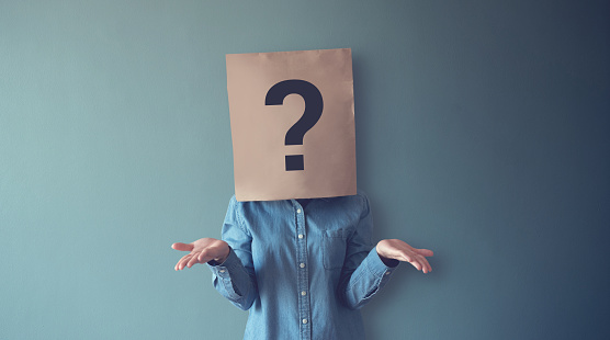 Woman Has Confused Thinking Question Mark Icon On Paper Bag Copy Space Stock Photo - Download Image Now