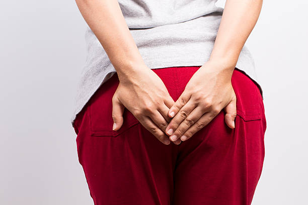 Woman has diarrhea and holding her butt stock photo