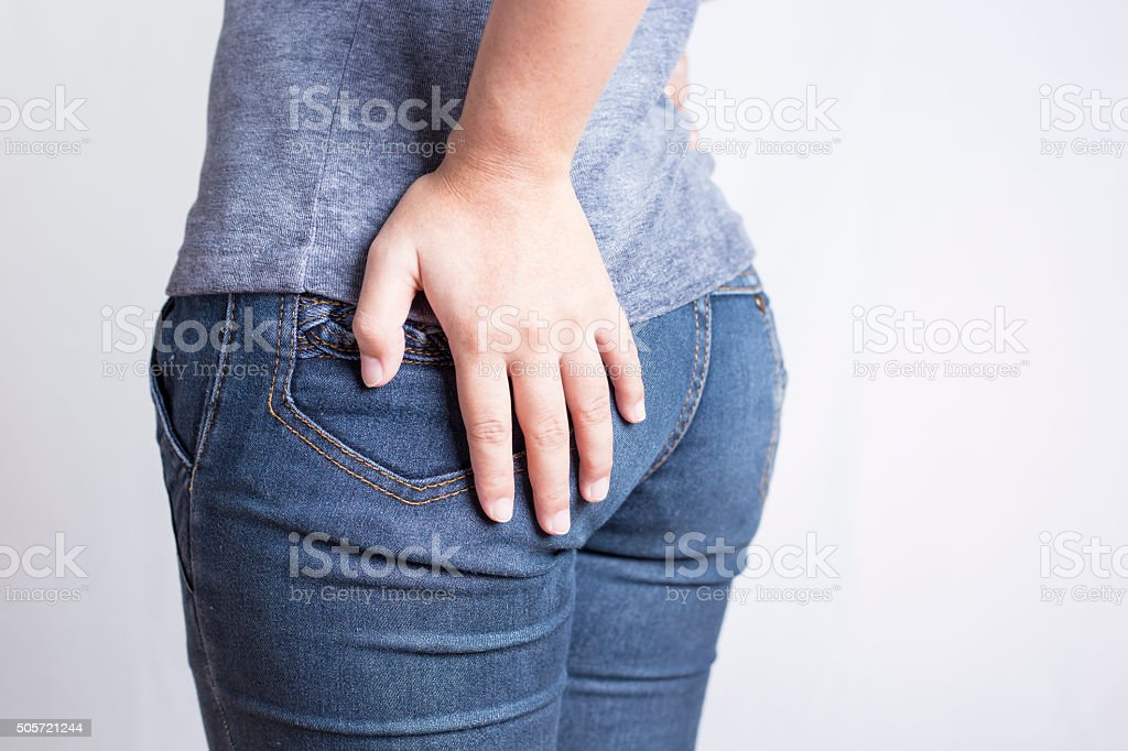 Woman has Diarrhea Holding his Butt: Isolated on White Backgroun stock photo