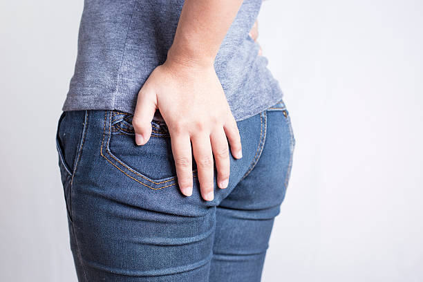 Woman has Diarrhea Holding his Butt: Isolated on White Backgroun stock photo