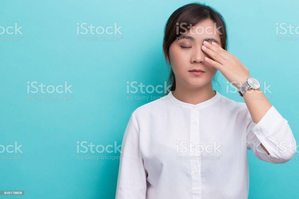 Woman has eye pain stock photo