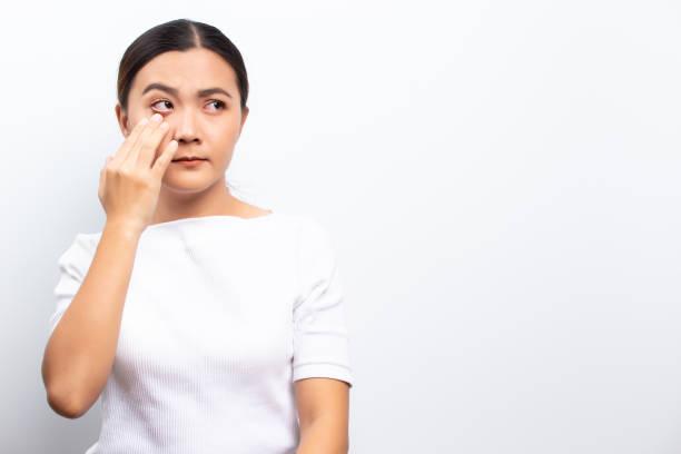 Woman has eyes pain stock photo