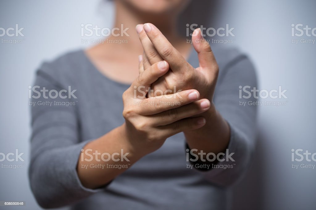 Woman has hand pain stock photo