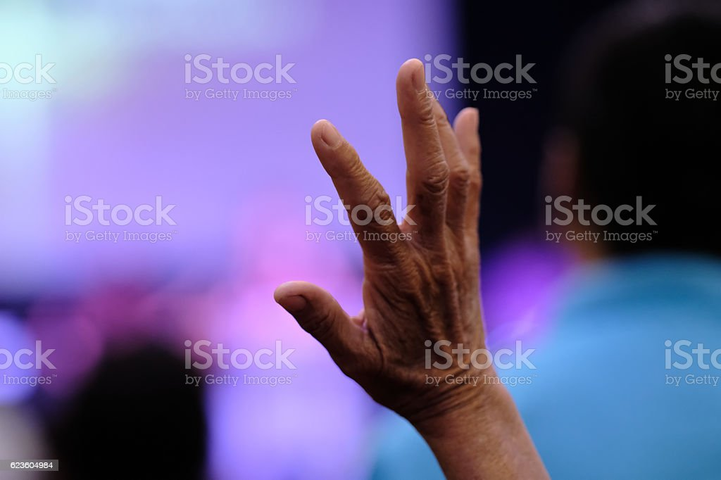 woman has lifting hands in prayer in the Christian church. stock photo