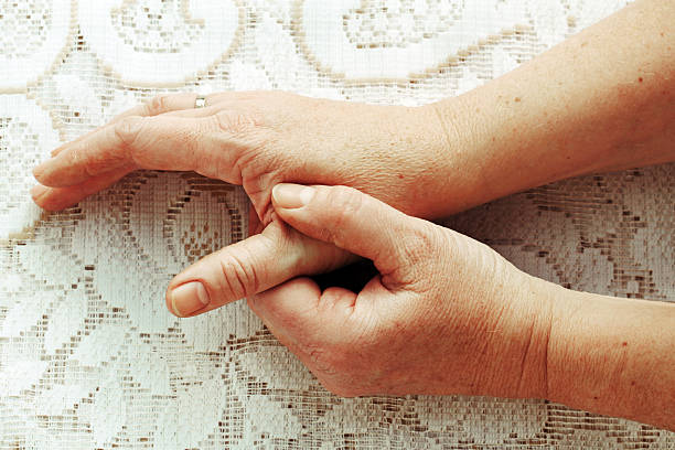 woman has pain in the fingers, hands, and joints - thumb stock photos and pictures