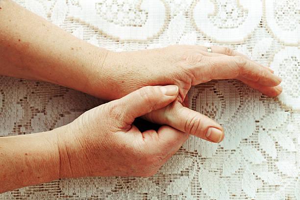 女性は痛み - 親指 ストックフォトと画像