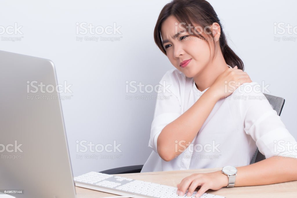 Woman has shoulder pain from work stock photo