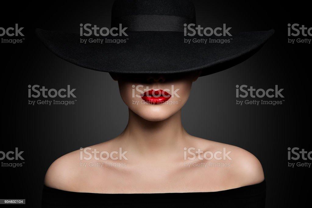 Woman Hat Lips and Shoulder, Elegant Fashion Model in Black Wide Broad Brim Hat, Retro Lady Beauty Portrait stock photo