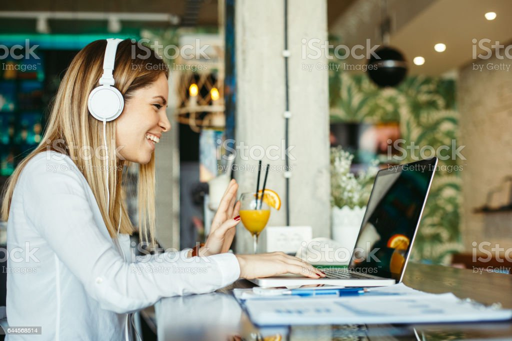 Woman have business meeting via video call in a cafe stock photo