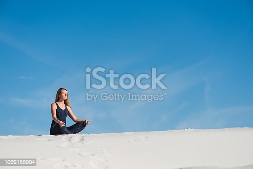 istock Woman have meditation in the desert sand 1039188994