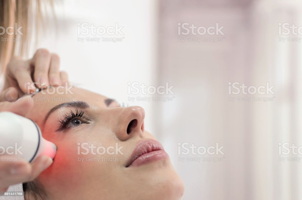 Woman have radio wave face lifting stock photo