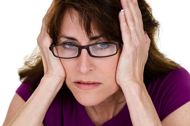 woman having a bad day - mature woman fever on white bildbanksfoton och bilder