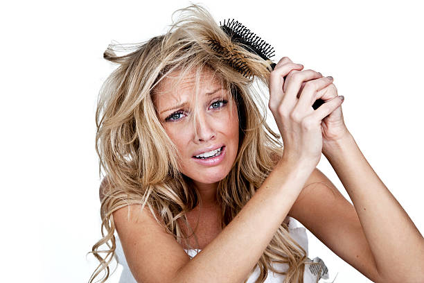 woman having a bad hair day - messy hair stock photos and pictures