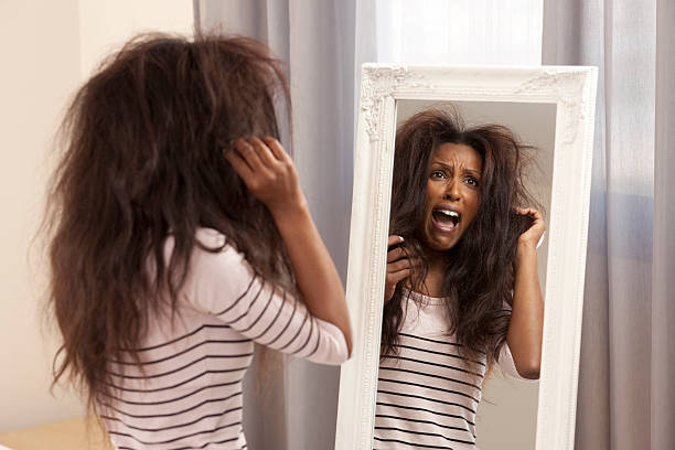 woman having a bad hair day. - messy hair stock photos and pictures