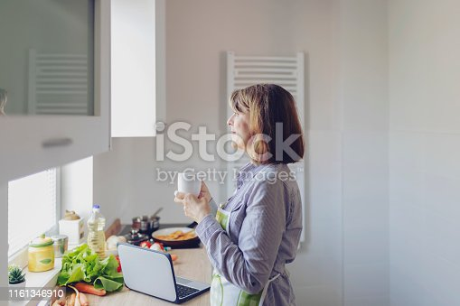 638765726 istock photo Woman Having a Cup of Coffee 1161346910