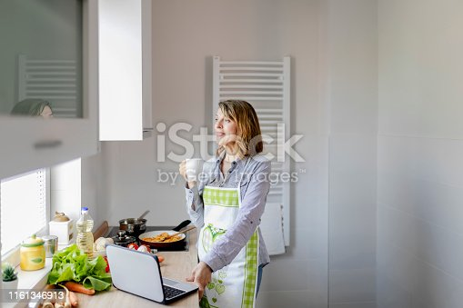 638765726 istock photo Woman Having a Cup of Coffee 1161346913