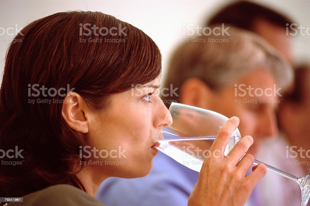 Woman having a drink of water 免版稅 stock photo
