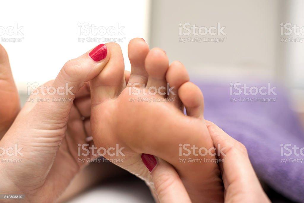 Woman having a feet pedicure treatment at spa beauty salon stock photo