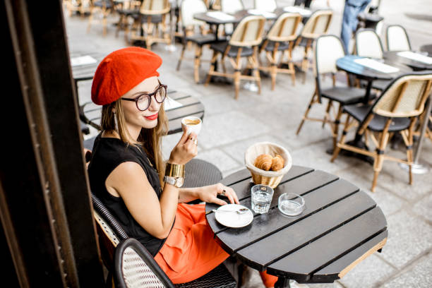 Woman having a french breakfast at the cafe stock photo