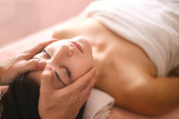 Woman having a head massage stock photo