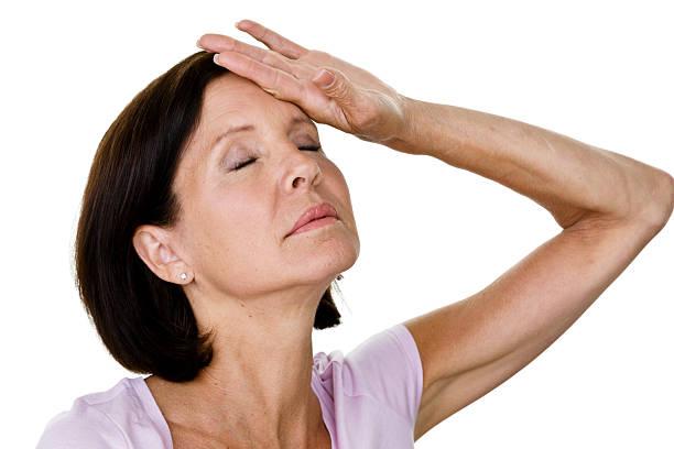 woman having a hot flash - mature woman fever on white bildbanksfoton och bilder