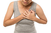 istock Woman having a pain in the heart area on white background 1037595772