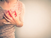 istock Woman having a pain in the heart attact. Medical and health care concept. 825424786