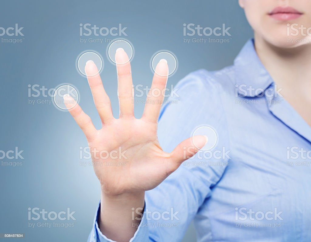 Woman having a palm print identification stock photo