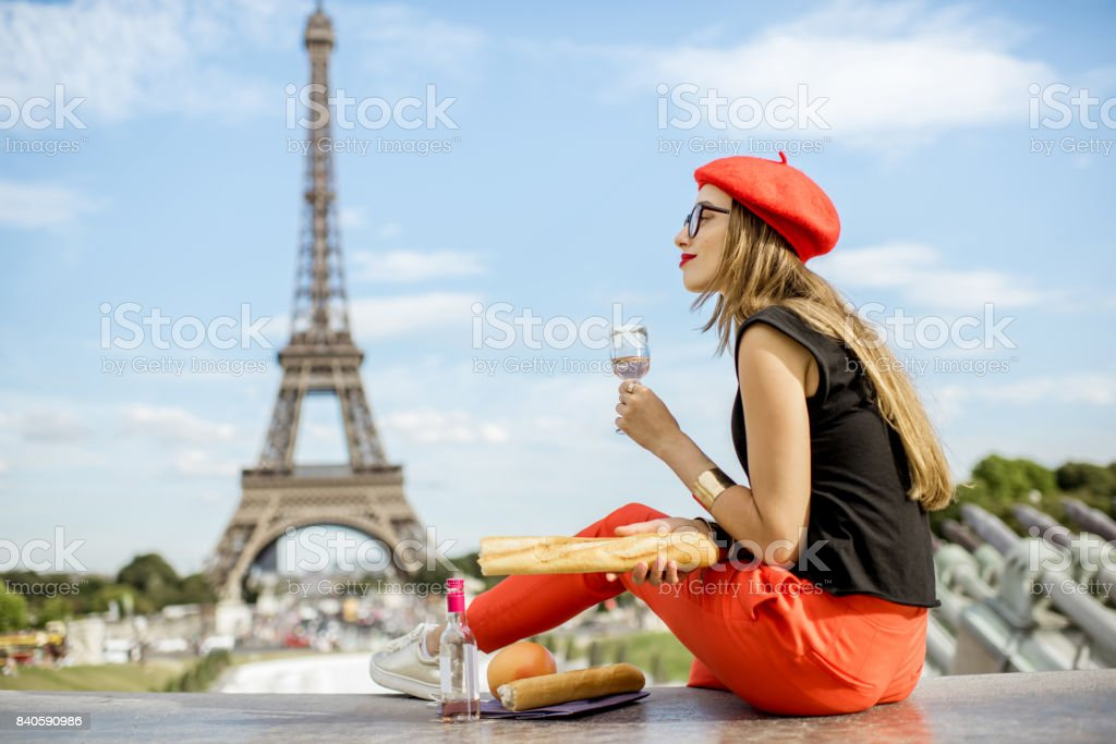 Woman having a picnic in Paris stock photo