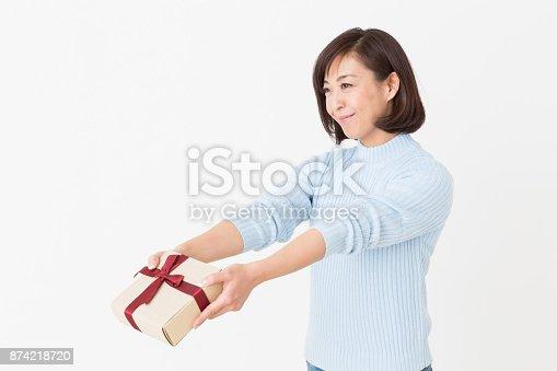 874218810 istock photo woman having a present 874218720