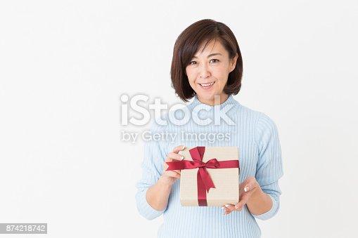 874218810 istock photo woman having a present 874218742