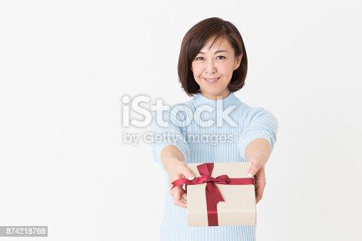 874218810 istock photo woman having a present 874218768