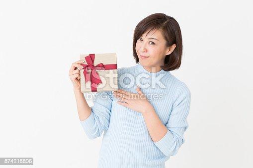 874218810 istock photo woman having a present 874218806