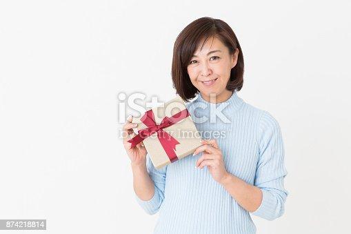 874218810 istock photo woman having a present 874218814