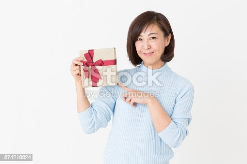 874218810 istock photo woman having a present 874218824