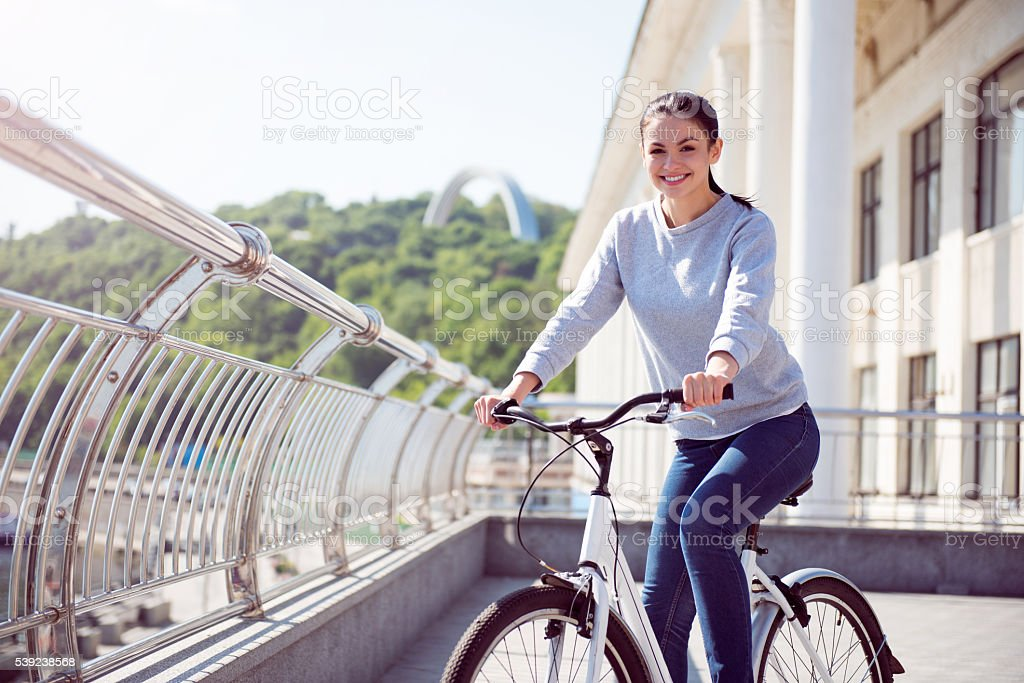 Woman having a rest on bike royalty-free stock photo