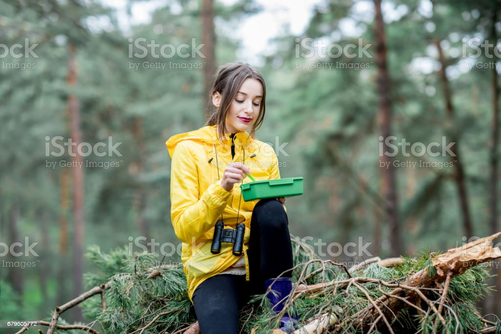 Woman having a snack in the forest royalty-free stock photo