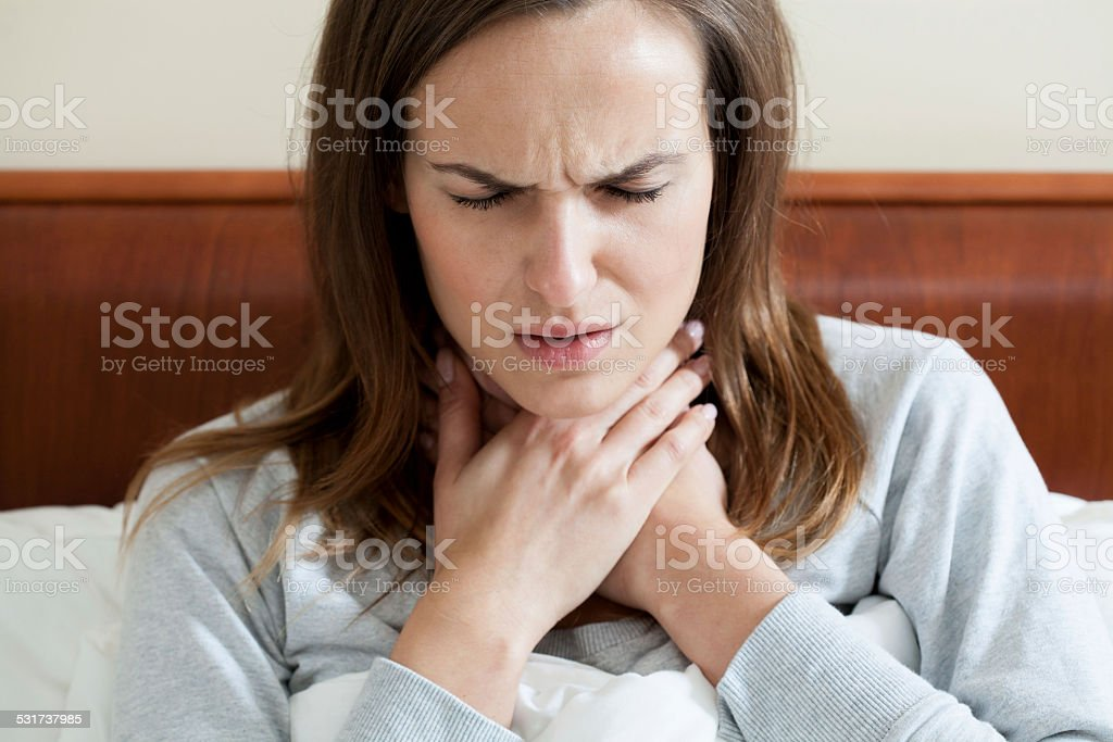 Woman having a sore throat stock photo