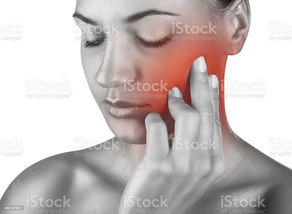 Woman having a toothache - illustrative photo stock photo
