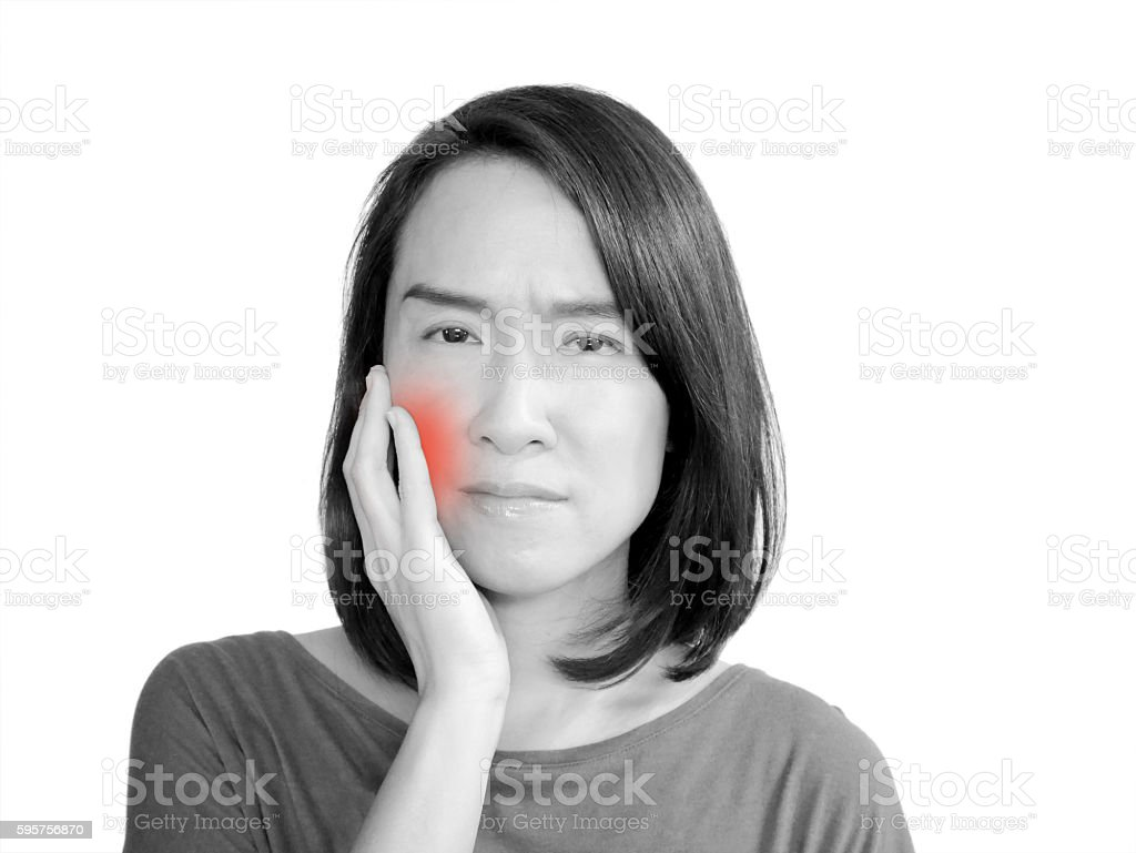 Woman having a toothache stock photo