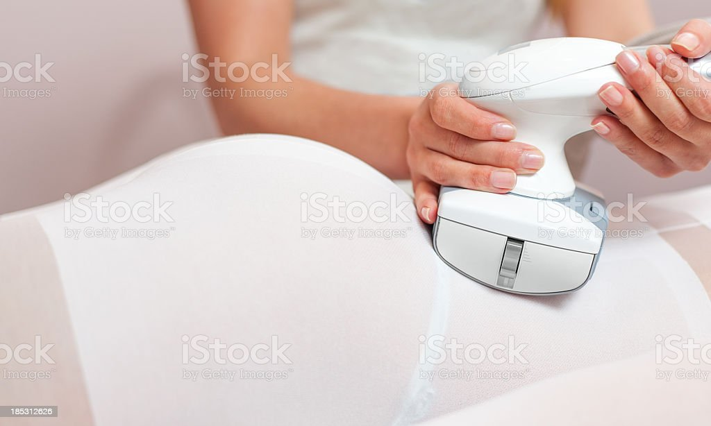 Woman having a treatment against cellulite royalty-free stock photo