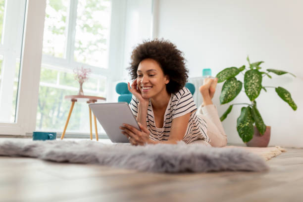Woman having a video call on tablet computer stock photo