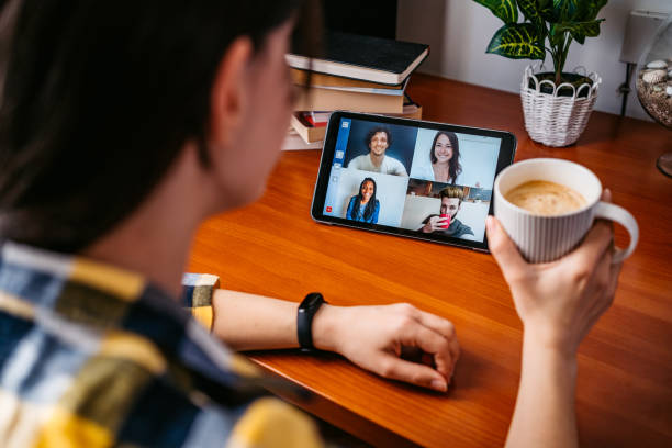 Woman having a video call with friends – zdjęcie