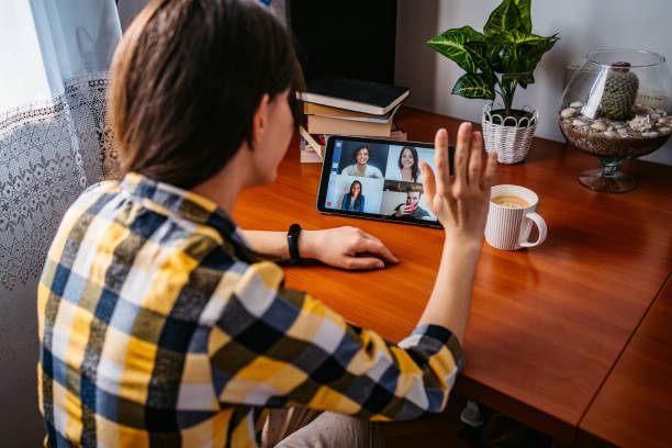 Woman having a video call with friends stock photo