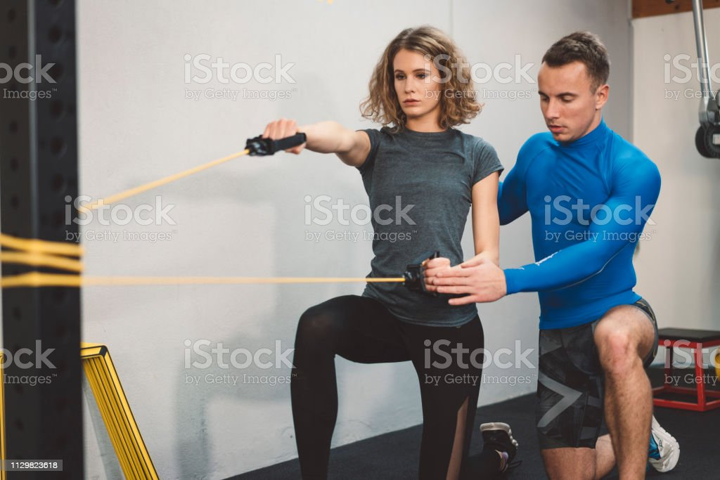 Woman having a workout session with her trainer