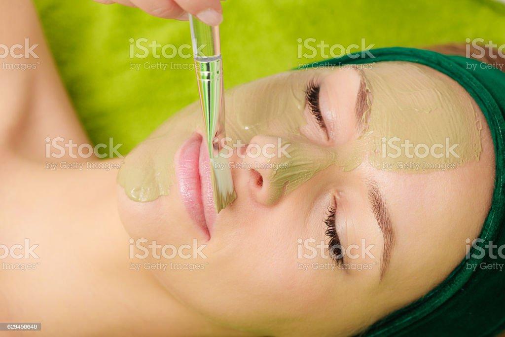 Woman having algae mud mask on face - Photo
