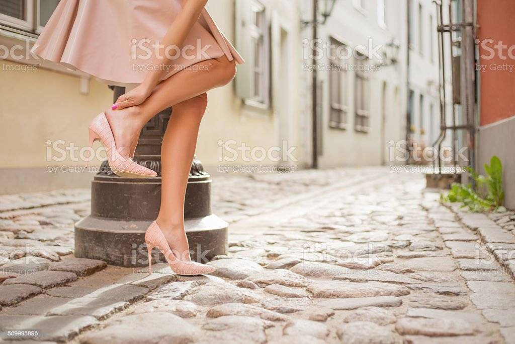 Woman having ankle pain stock photo