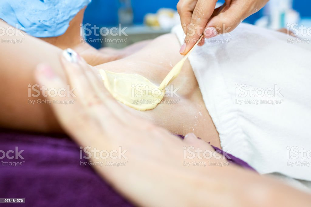 Woman having armpit hair removed stock photo