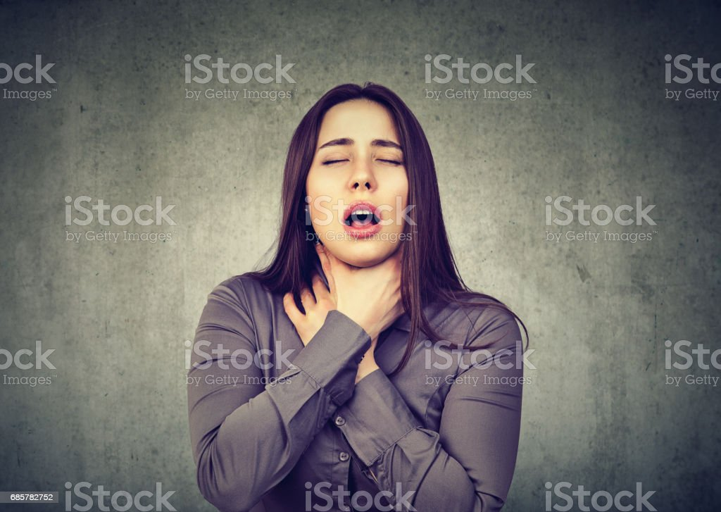 Woman having asthma attack or choking can't breath suffering from respiration problems royalty-free stock photo