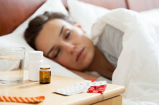 woman having autumn flu - sleeping pill stock photos and pictures